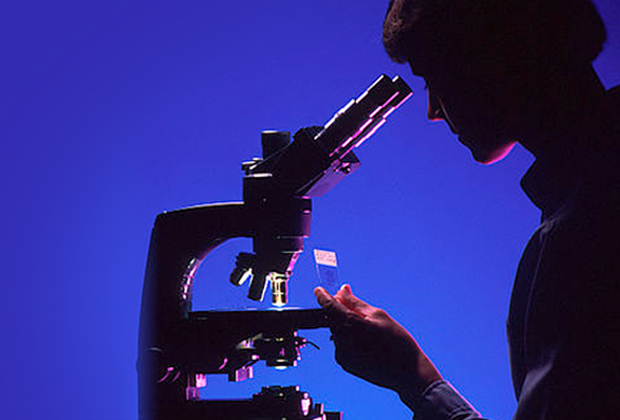 Pathologist with microscope