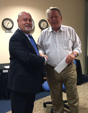 LRG Executive Director, Norman Scherzer accepts a generous donation from Jose Murado of Investors Bank, one of our sponsors.
