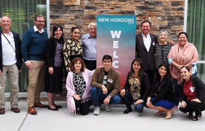 New Horizons 2019 participants in front of banner
