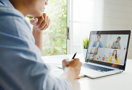 Man at computer working from home